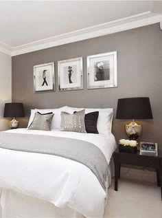 Sleek dark bedroom in white blacn and silver