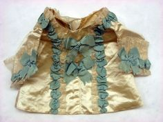 Infant's jacket, Sweden, 1778. Cream silk satin with green silk ribbon trim.