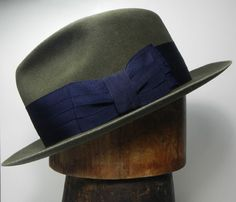 """The Esquire- Shown in moss felt with 2 1/8"""" by-fold ribbon 5"""" crown with 4 1/2"""" center dent 2 1/4"""" brim with Halo Trim. 100% pure beaver felt    $370"""