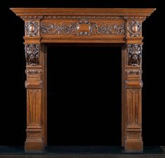 antique fireplace mantel in oak with lion mask