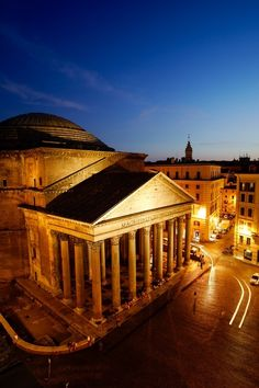 The Pantheon, Rome, Italy - commissioned by Marcus Agrippa as a temple to all the gods of ancient Rome. The building is circular with a portico of large granite Corinthian columns (eight in the first rank and two groups of four behind) under a pediment. It features a central opening (oculus) to the sky. Almost 2,000 years after it was built, the Pantheon's dome is still the world's largest unreinforced concrete dome