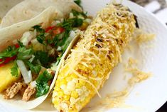 """Broiled Corn on the Cob Rolled in Smoky Chili Butter and Parmesan. How an indoor kid does classic """"grilled"""" corn"""