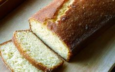 Lemon-Drenched Lemon Cake Makes 2 loaves  For the cake: 2 2/3 cups all-purpose flour 2½ teaspoons baking powder a pinch of salt 2⅓ cups sugar 1½ teaspoons vanilla extract 6 large eggs, at room temperature 2/3 cup heavy cream Zest of 2 lemons, finely grated 1 stick, plus 7 tbsp unsalted butter (15 tbsp total), melted and cooled  For the syrup: 1/3 cup water 1/2 cup sugar Juice of two lemons