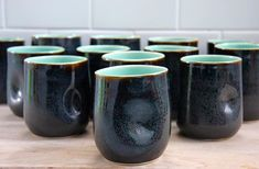 @ofhandstudios  Read the original post below.  Just pulled a bunch of these coal tumblers out this morning. What a fantastic firing...kiln gods were on my side today!  ---------------------------------------------------- #pottery #ceramics #clay #porcelain #keramik #ceramique #craft #tumblers #coffee #bourbon #barware #tableware #homegoods #makersgonnamake #contemporaryceramics #contemporarycraft #handmadetableware #handmadeceramics #onthetable #tabletop #mycommontable #livefolk…