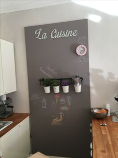 Board in kitchen with grey taupe colour