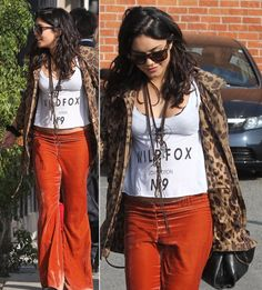 Velvet bell bottom flares, black and white graphic typography tee, leopard jacket, layered necklaces and sunglasses with messy waves.