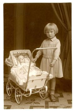Vintage photo of little girl and her doll.