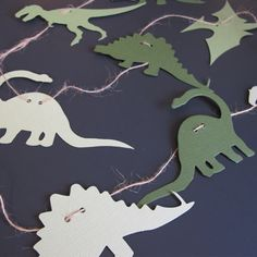 Dinosaur garland, Print dinosaurs on paper and cut around them as dinosaur foot prints and egg shapes for easier/less cutting.