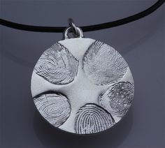 Fingerprints forever! How cool is this? I'd love to have this done with all 5 of my kid's prints. :)