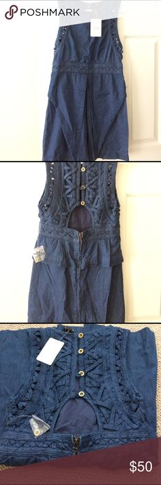 NWT! Free People denim dress NWT. New Romantics by free People dress. Back exposed with and zipper that goes all the way down. Great with gladiators or heels! Detail on here is amazing ! Free People Dresses Backless