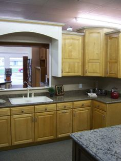 Cabinets can be designed around existing structures to make any space into your dream kitchen