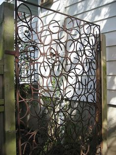 completed garden gate, in its initial final location. Just over of rebar all cut into lengths and cold bent by hand. yes, a bit obsessive compulsive. Wooden Garden Gate, Garden Gates And Fencing, Wooden Pergola, Garden Paths, Fence Gates, Driveway Gate, Metal Gates, Wooden Gates, Wrought Iron Gates