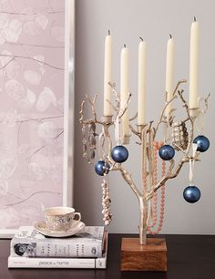 A twig candleholder does double duty, offering a spot to hang pretty necklaces and a few small Christmas ornaments.