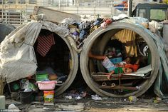 Many of the Philippines' desperate citizens dwell in whatever makeshift shelters they can ...
