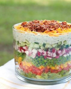 Seven Layer Salad seriously the best healthiest salad I've ever loved! The post Layered Salad appeared first on Tasty Recipes. One Dish Meals Tasty Recipes Think Food, Love Food, Great Recipes, Favorite Recipes, Popular Recipes, Yummy Food, Tasty, Snacks Für Party, Summer Salads