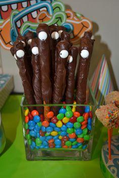 Chocolate covered pretzels w sugar eye balls