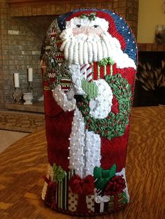Polly stitched this Melissa Shirley Santa with Park Avenue Needlepoint.