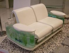 """This sofa features aquariums on both its sides. So all those who love keeping fishes in your home, then this is a must have for you. Its priced at just USD 12,000…not bad!"""""""