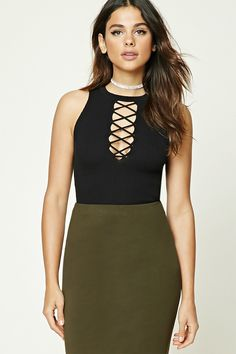 A ribbed knit crop top featuring a plunging lace-up front, round neckline, and a sleeveless cut.