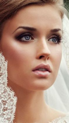 Stunning wedding makeup! Dramatic but not over-done, smokey eyes with a neutral lip and highlighted cheekbones does the trick.
