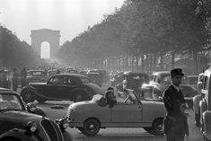 29 Vintage Photos of Paris, from the Moulin Rouge to the Louvre | Condé Nast Traveler