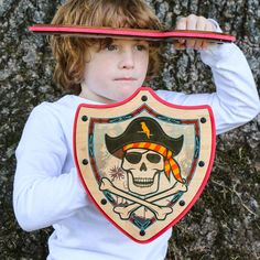 Wooden Pirate Shield for Kids (Red/Blue) by MIGHTY FUN! on Etsy. Our wooden pirate shield features a vivid, full-color design printed on real wood. This is a fantastic pretend play toy or costume accessory for any child that loves pirates. Handmade from real wood and soft foam in Portland, Oregon.