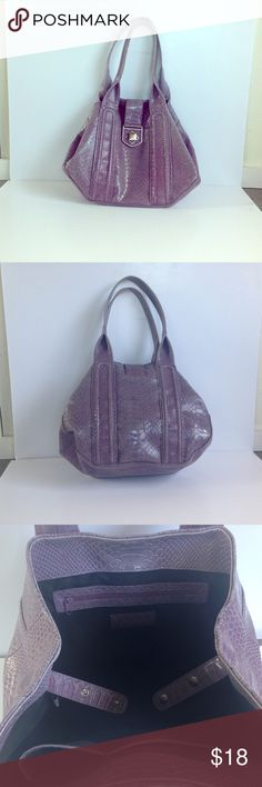 Lavender/purple Worthington Shoulder Bag Her is a roomy shoulder bag. The purple exterior is faux alligator with stylish brushed silver tone hardware and one pocket behind the clasp. Th interior is black fabric with one zipper compartment and 2 open pockets. Approximately 14x11x5. 9 inch strap drop. Let me know if you have any questions. I'm always open to offers. Worthington Bags Shoulder Bags