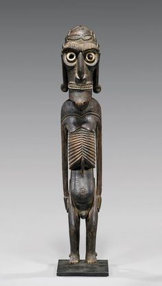 """ANTIQUE EASTER ISLAND WOOD FIGUREAntique Easter Island (Rapa Nui), wood moai kavakava figure: used in ceremonial dance ritual by kahuna priest, elegantly carved with inset shell eyes and obsidian pupils; probably late 19th Century; H: 24 3/4""""; stand; Provenance: Australian collection. Pre-auction est.: $5,000-$6,000"""