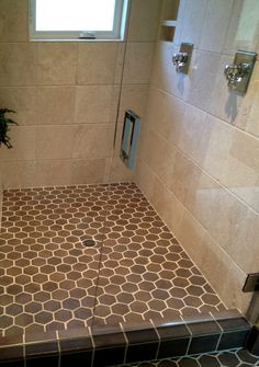 brown hexagon tiles and square wall tiles