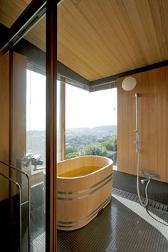 The Art of the Japanese Bath   Cliff House by Yoshifumi Nakamura. Perched atop the cliff in Kanagawa Prefecture, this bathroom occupies southwest corner facing Mt. Fuji. The custom-order Japanese umbrella pine bathtub sits quaintly in the middle of the space.