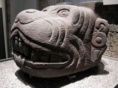 ancientart:  Sculpture of Xolotl.  An important figure within the rituals surrounding the god Quetzalcoatl is Xolotl, his twin, a peculiar god in the form of a dog, identifiable by the many wrinkles on the sacred canine and the two rectangular protuberances on its head, relating it with the heavenly fire. According to legend, to create man Quetzalcoatl traveled to the underworld to search for the bones of the ancestral generations, guarded over by Mictlantecuhtli.