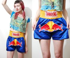 ☩THAI BOXING SHORTS 90s vintage shorts Silky blue satin High elasticated waist Embroidered red bull patch on the front Label: - Size on