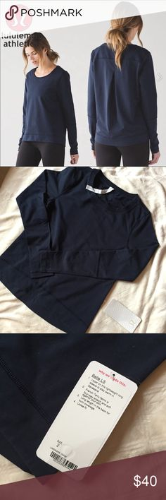 Lululemon Belle Long Sleeve in Navy Size 2 Lululemon Belle Long Sleeve in Navy Size 2. Pleat detail in the back. Fits like your usually size 2 at lululemon. Perfect for fall and winter, post workout, running errands, etc. Pleat detail in the back. Never worn. lululemon athletica Tops Tees - Long Sleeve