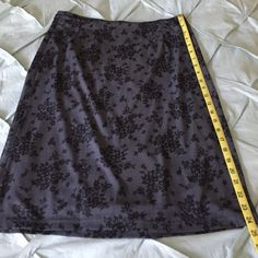 Black and gray printed Express skirt Black and gray printed Express skirt is about 24 inches long gray lining is about 2 inches shorter than sheer layer. 100% polyester. Only worn once Express Skirts