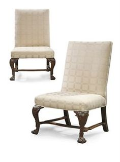 A PAIR OF IRISH GEORGE II MAHOGANY SIDE CHAIRS  CIRCA 1750  Each with back and seat upholstered in ivory damask, on acanthus carved cabriole legs with claw feet joined by waved stretchers, later blocks  39½ in. (100.5 cm.) high; 25½ in. (65 cm.) wide; 26½ in. (67.5 cm.) deep (2)