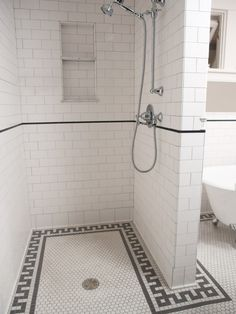 Subway tile, hex tile floor. I like the built-in shower shelf.