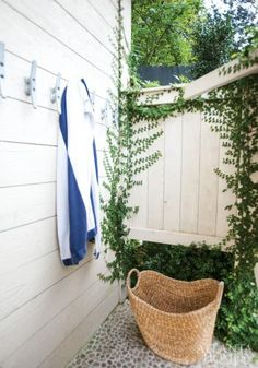 Uncovered Gem: Boat cleats provide a place to hang towels in this outdoor shower.   Atlanta Homes & Lifestyles