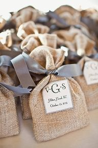 Favors in Little Burlap Bags tied with Ribbon.... ALL ABOUT HONEYMOONS specializes in Honeymoon & Destination Wedding planning. For more info go to: www.cori.allabouthoneymoons.com. Become our FAN on Facebook: https://www.facebook.com/AAHsf