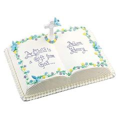 Entering the Fold Cake - Create an edible baptismal record to share at post-christening gatherings. Use our Decorating Comb to create a paged effect on an iced Book Pan cake bearing a personalized passage.