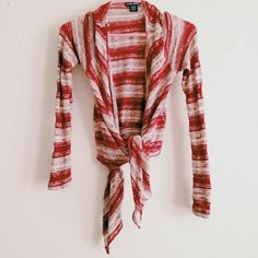 Red & cream striped shrug Red and cream striped shrug sweater from wet seal!  Perfect for 4th of July, paired with a white tee and jeans, but it's light enough for back to school as well.  Looks great loose or tied at the front.  Comment if you have any questions! Wet Seal Sweaters Shrugs & Ponchos
