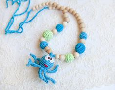 Octopus - Mommy / Teething Necklace - Nursing Necklace - wooden toy - waldorf toy -  Wrap Baby Carrier Sling Accessory. $34.00, via Etsy.