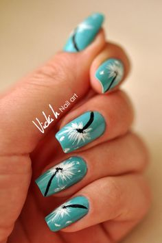 Give life to your nails by using a green blue base color for your Dandelion nail art ensemble. Paint a Dandelion each on your fingernails using white polish as the petals and black for the stems for effect.