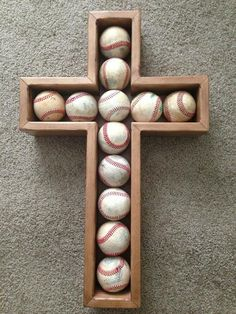 This is a great way to display those special baseballs. Baseballs can be attached with Velcro (not included) and the cross hung up. Baseballs NOT