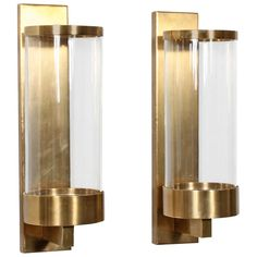 Pair of Modern Cylinder Glass and Brass Wall Sconces | From a unique collection of antique and modern wall lights and sconces at https://www.1stdibs.com/furniture/lighting/sconces-wall-lights/