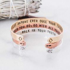 Give the gift of inspiration with these quote cuffs. The three quotes, outlined below, are hand stamped into the bracelets as secret messages. The chevron, arrow and diamond symbols serve as subtle reminders of the quotes within. You can purchase bracelets as a set for stacking or separately.