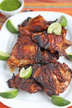 Smoked Grilled Peruvian Chicken - this chicken is bathed in a citrusy marinade and then smoked on the grill - incredibly delicious