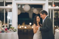 Bride and her father dance during a wedding reception at Oceanblue/Westhampton Bath & Tennis in Westhampton, NY. Captured by NYC wedding pho...