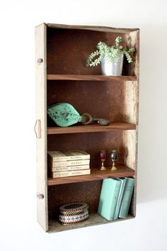 Rusted factory drawer repurposed into a industrial style shelving unit.
