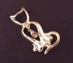 This adorable brooch captures kitty's grace and whimsical charm. http://stores.ebay.com/Stuff4Uand4U