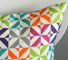 Simple & sweet- the link does not take you to the quilt - but it would be pretty simple to figure out.  Good use of solid fabrics.